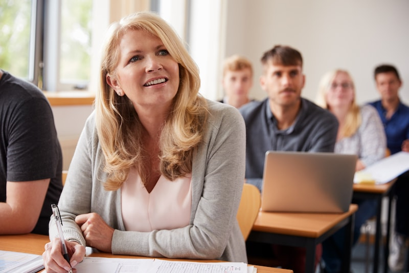 mature woman in a classroom